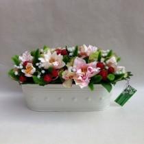 Centre de flors artificials per decorar la teva llar
